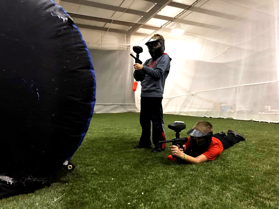 two boys playing indoor paintball fun things to do