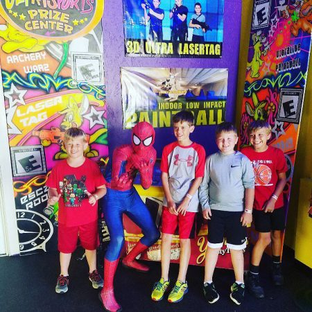 Kids birthday posing with spider man at Jack's Ultra Sports